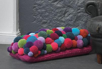 MYK pom-pom cushion